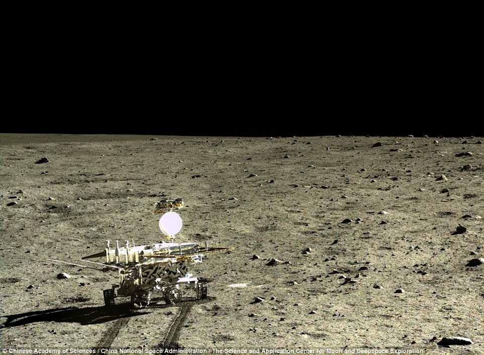 Time to make tracks:The Yutu 'Jade rabbit' is seen moving away from the Chang'e 3 lander over the moon's featureless, rock-strewn surface