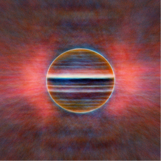 A new radio view of Jupiter at three wavelengths: 2 cm in blue, 3 cm in gold and 6 cm in red. Researchers created this image from 10 hours of data, averaged, so instead of fine detail the features are smeared by the planet's rotation. The pink glow comes from radiation caused by electrons trapped in Jupiter's magnetic field.
