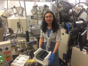IBM scientist Guohan Hu holds an STT MRAM wafer.